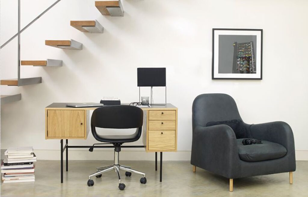 Wooden desk with black chair